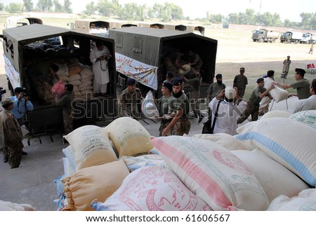 PESHAWAR, PAKISTAN, SEPT 23: Army officials shift relief goods from trucks which were donated by army and civilians of Punjab for flood affectees of Khyber-Pakhtoonkhawa, September 23, 2010 in Peshawar, Pakistan