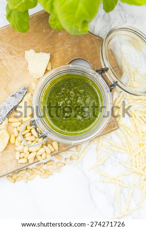 Pesto alla genovese, basil, parmesan, pine-nuts, olive oil and trofie-noodles - stock photo