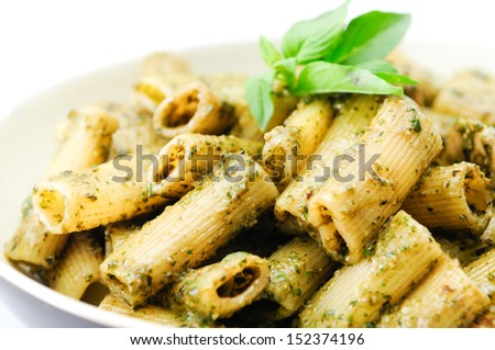 pesto pasta with chicken, basil and parmesan cheese and sweet peas - stock photo