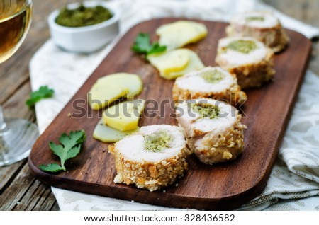 pesto stuffed crumbs chicken. the toning. selective focus - stock photo