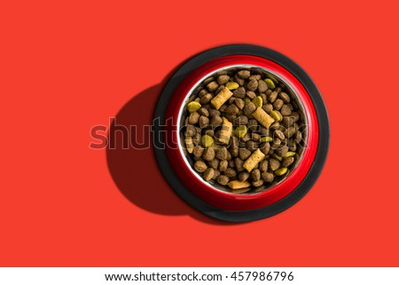 Pet food over a red background