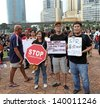 PETALING JAYA, MALAYSIA - MAY 25: Malaysian youth with political placard at a protest rally against alleged fraudulent 13th general election on May 25, 2013 in Padang Timur, Petaling Jaya, Malaysia. - stock