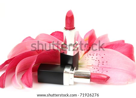 Petals of pink lilies and lipstick