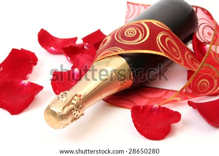 Petals of roses and bottle