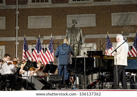 Peter Nero and the Philly Pops performing in front of historic Independence Hall, Philadelphia, Pennsylvania on July 3, 2008 - stock photo