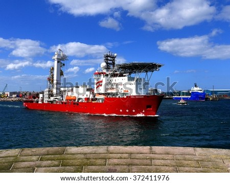 "Peterhead, Scotland, 3rd of July 2014, Offshore Diving Support vessel ""Well Enhancer""  leaving harbor for offshore location. - stock photo"
