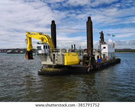 Peterhead, Scotland, 20th of May 2009, Bucket Dredger Manu Pekka during harbour construction works. - stock photo
