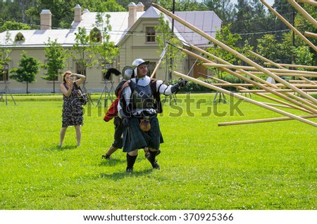 "PETERHOF- JULY 07: Reconstruction of knightly fight on July 07, 2013, SAINT-PETERSBURG, RUSSIA. The festival ""Alexandrian roundabout"" takes place in the Alexandria Park in Peterhof every summer"