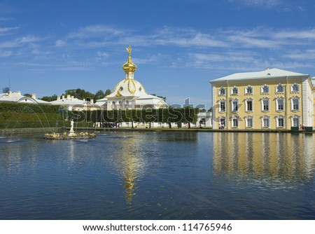 Peterhof, Russia, fountains and church in park near king's palace, in surroundings of St. Petersburg. - stock photo