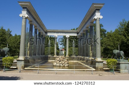 "PETERHOF, RUSSIA - JULY 06: fountain ""Lion cascade"" in park near king's palace, July 06, 2012, in town Peterhof near St. Petersburg, Russia, Peterhof built by order of king Peter I Great in 1714. - stock photo"