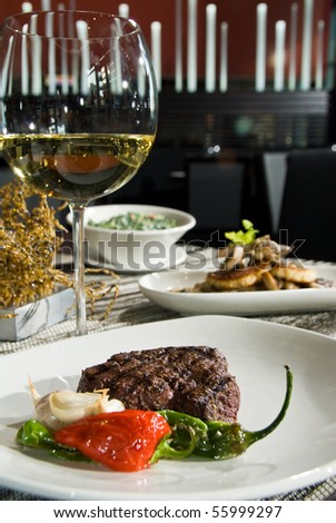 Petit filet of steak with side of mushrooms and creamed spinach - stock photo