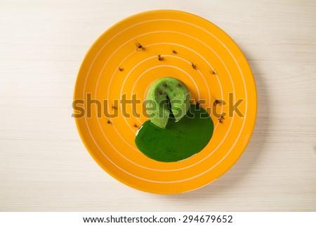 petit gateau with green sava ant - stock photo