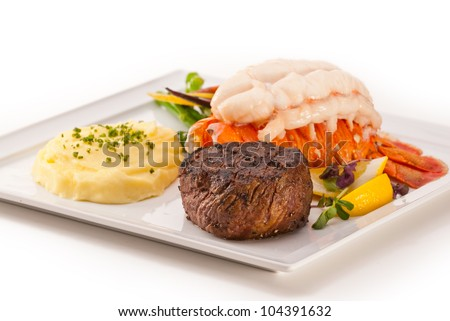 Petite Fillet and Lobster, focus on meat, on white - stock photo