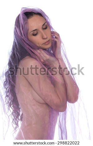 Petite young brunette wrapped in purple tulle