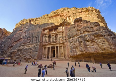 PETRA, JORDAN - 12OCTOBER, 2014: The treasury is also called Al Khazna, it is the most magnificant and famous facade in Petra Jordan, it is 40 meters high. - stock photo