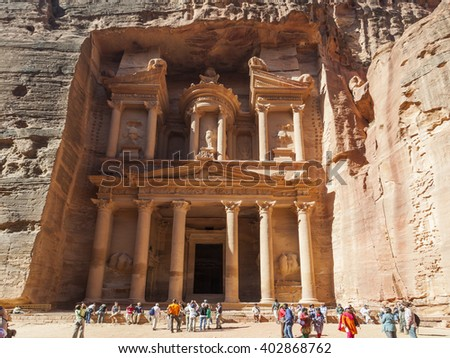 PETRA, JORDAN - OCTOBER 29, 2014: The treasury - Petra's most elaborate ruin, is also called Al Khazna, hewn into the sandstone cliff.