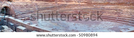 Petra panoramic view - Nabataeans capital city (Al Khazneh) , Jordan. Made by digging in the rocks. Roman Empire period. Amphitheater detail. - stock photo