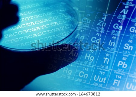 Petri dishes in arm with chemical elements. Laboratory concept. - stock photo