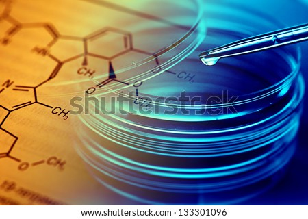Petri dishes, pipette and chemical formula. Laboratory concept. - stock photo