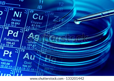Petri dishes, pipette and periodic table of elements. Laboratory concept. - stock photo