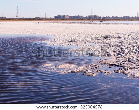 Petrified salt made dry red estuary. Kuyalnik in Odessa, Ukraine. The water has receded far into the result of the strong summer drought. Ecological catastrophy. The destruction of nature. - stock photo