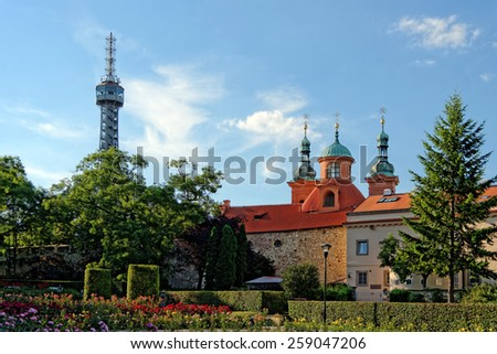Petrin Tower, St. Lawrence Church, Chapel of the Holy Sepulchre and Calvary, and The Hunger Wall, Prague, Czech Republic. - stock photo