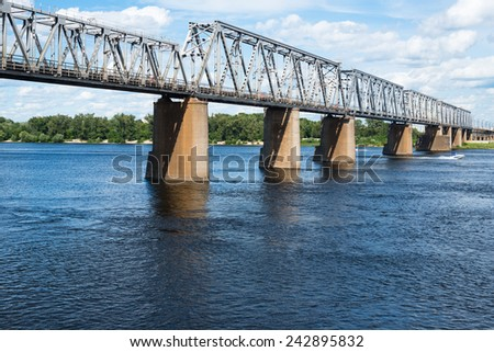 Petrivskiy railroad bridge in Kyiv (Ukraine) across the Dnieper. View from the right bank of the river. - stock photo