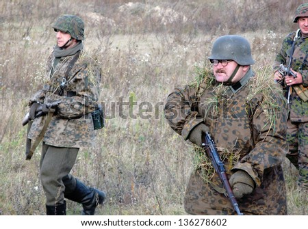 PETRIVTSI, UKRAINE - NOVEMBER 04: Wehrmacht soldiers during reconstruction of the battle liberation by Soviet troops Lyutezh beachhead during WWII on November 04, 2007 in Petrivtsi (Kiev), Ukraine