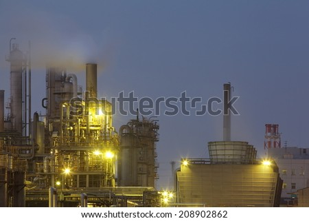 petrochemical industrial plant or oil refinery at twilight  - stock photo