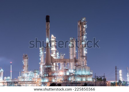 Petrochemical industrial plant power station at dark of Thailand - stock photo