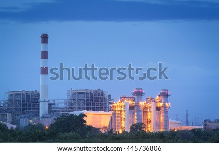 Petrochemical industry at night - power plant factory  - stock photo