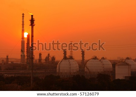 Petrochemical industry during sunset - stock photo