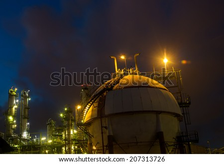 petrochemical plant and sphere tank gas at night - stock photo