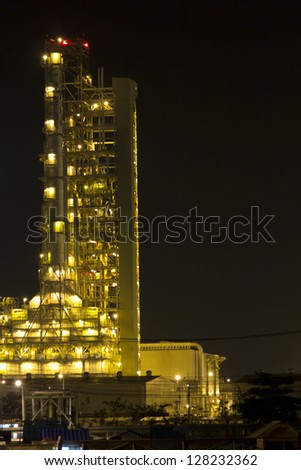 Petrochemical plant at night in Thailand - stock photo