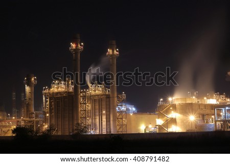 Petrochemical plant at night soft focus
