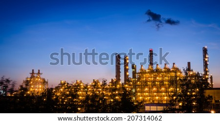 petrochemical plant column tower at dawn - stock photo