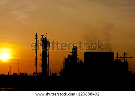 petrochemical plant in silhouette image at sun set