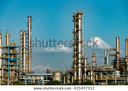 Petrochemical plant with blue sky - stock photo