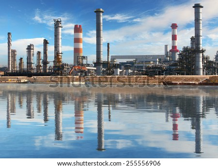 Petrochemical plant with reflection in water, Oil Industry - stock photo