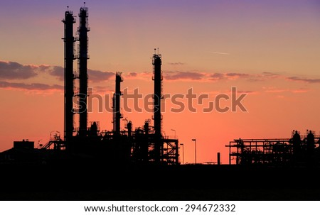 Petrochemical refineries in the sunset - stock photo