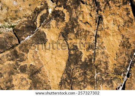 Petroglyphs carved into the rock in Utah. - stock photo