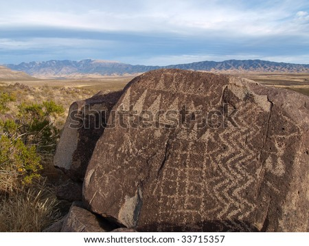 Petroglyphs carved on rock surface by prehistoric Native American(s) at the Three Rivers Petroglyph site in New Mexico, USA. - stock photo