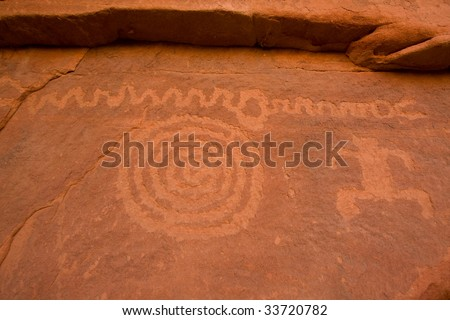 Petroglyphs carved on surface of cliff wall by prehistoric Native American(s) in Zion National Park, Utah, USA. - stock photo
