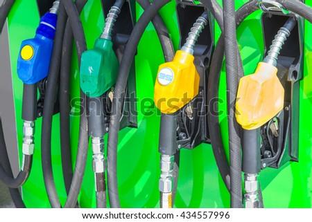 Petrol pump filling - stock photo