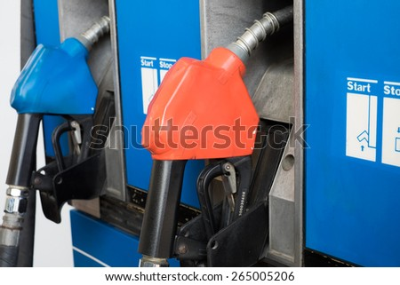 petrol pump nozzle - stock photo