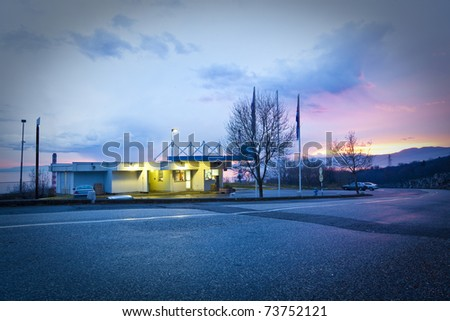 petrol station at the sunset - stock photo