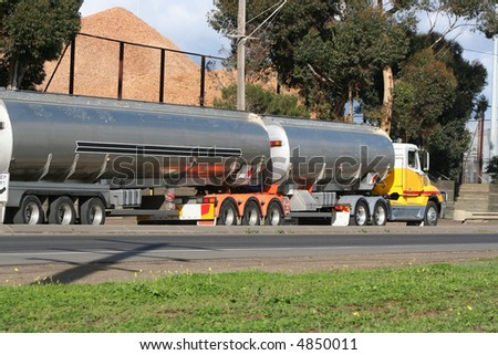 Petrol tanker semi truck - stock photo