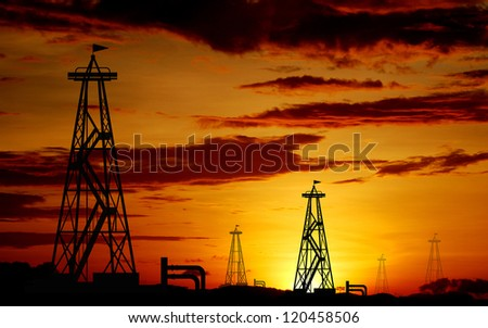petroleum industry oil rig sunset background for design - stock photo