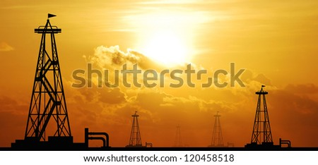 petroleum industry oil rig sunset background for design