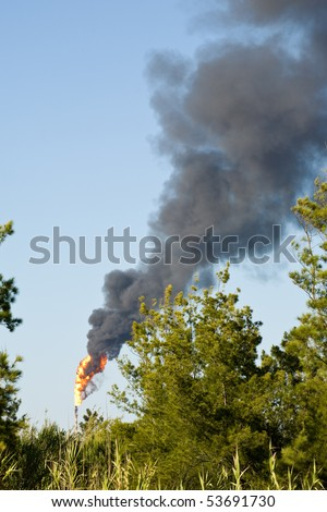 Petroleum refinery torch at Sines, Portugal - stock photo